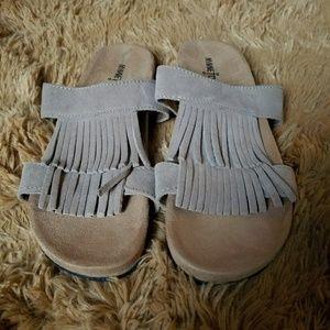EUC Minnetonka leather  fringe sandals size 9